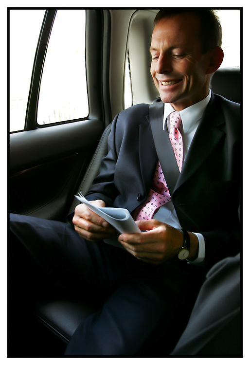 Health minister Tony Abbott on his way to tullamarine airport in a com car  Pic By Craig Sillitoe