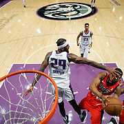 Reno Bighorns Forward JAKARR SAMPSON (29) attempts to block the shot of Raptors 905 Guard AARON BEST (2) as Raptors 905 Forward ALFONZO MCKINNIE (34) looks on during the NBA G-League Basketball game between the Reno Bighorns and the Raptors 905 at the Reno Events Center in Reno, Nevada.