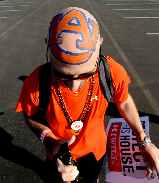 Daily Photo by Gary Cosby Jr.   ..Anthony Glackmeyer wears a giant Auburn logo on top of his head before the BCS National Championship Game in Glendale, AZ Monday, January 10, 2011.