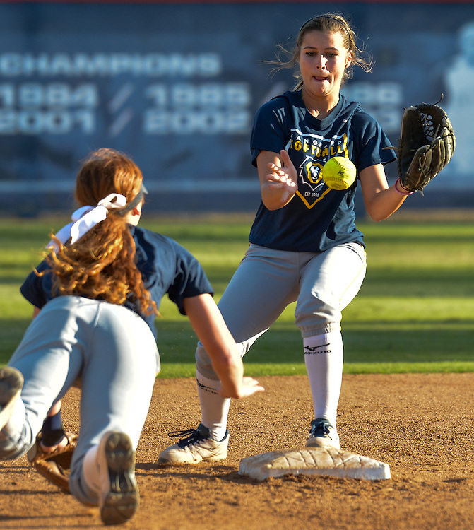 Vanguard University second basemen, Summer Penner receives the ball from her teammate to turn a double play during a game against Allan Hancock College. November 4th, 2016 — Vanguard University vs Allan Hancock College — Women's Softball — Anderson Family Field, Cal State Fullerton, Fullerton, CA<br /> <br /> Photo by Austin Song / Sports Shooter Academy