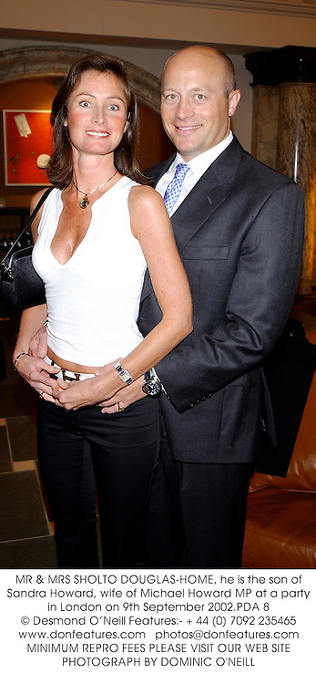 MR & MRS SHOLTO DOUGLAS-HOME, he is the son of Sandra Howard, wife of Michael Howard MP at a party in London on 9th September 2002.PDA 8