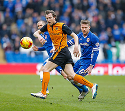 Kevin McDonald of Wolverhampton Wanderers is challenged by Aron Gunnarsson of Cardiff City - Photo mandatory by-line: Rogan Thomson/JMP - 07966 386802 - 28/02/2015 - SPORT - FOOTBALL - Cardiff, Wales - Cardiff City Stadium - Cardiff City v Wolverhampton Wanderers - Sky Bet Championship.