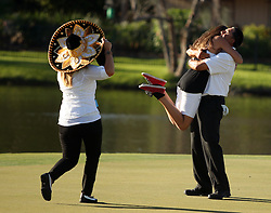 Esteban Toledo hugs his daughter Eden as wife, Colleen, approaches after Toledo defeated Mike Goodes on the third playoff hole on No. 17 during the final round of the Insperity Championship, Sunday, May 4, 2013 at The Woodlands Country Club Tournament Course in The Woodlands, TX.
