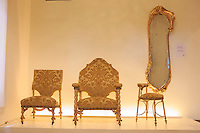 Unusually designed furniture on display in the Antoni Gaudi House-Museum within Park Guell in Barcelona, Spain