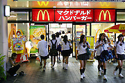 McDonald's and other fast food chains, both global and Japanese, are a frequent stop for busy Okinawans. Although the island is being studied for clues to Okinawan's great longevity, studies say that the younger population will not live as long because their diets are higher in saturated fats and calories. (Supporting image from the project Hungry Planet: What the World Eats).