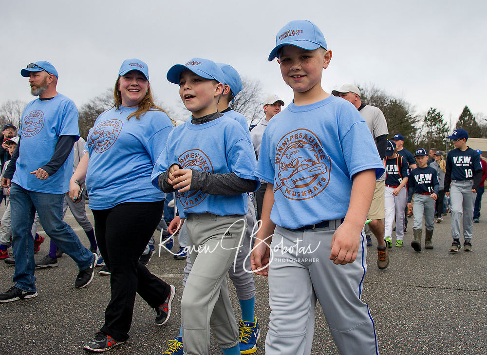 The Winnipesaukee Muskrats Minor league team marches into Opechee Park Saturday morning during the opening day Laconia Little League parade.  (Karen Bobotas/for the Laconia Daily Sun)