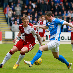 Marttyn Waghorn tries to cut back inside Tom Scobbie as he heads down the wing