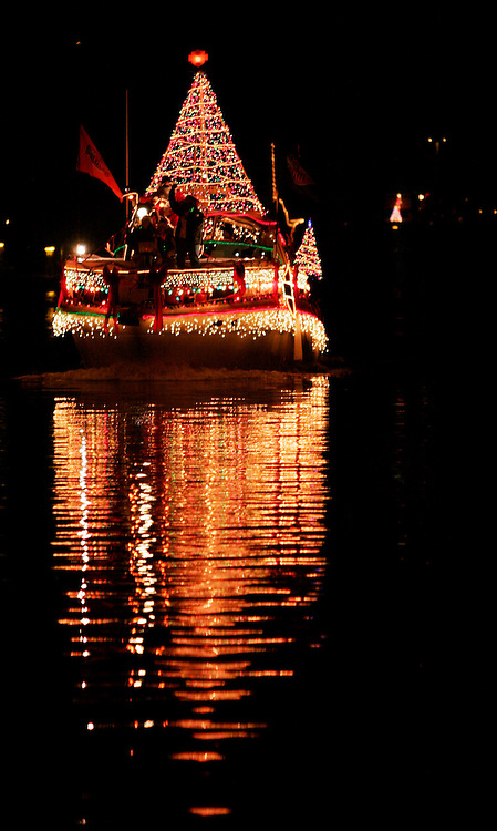 One of the crowd favorites at the Carolina Beach Island of Lights Flotilla was Harley-Davidson themed boat, complete with Santa revving up a bike on deck.