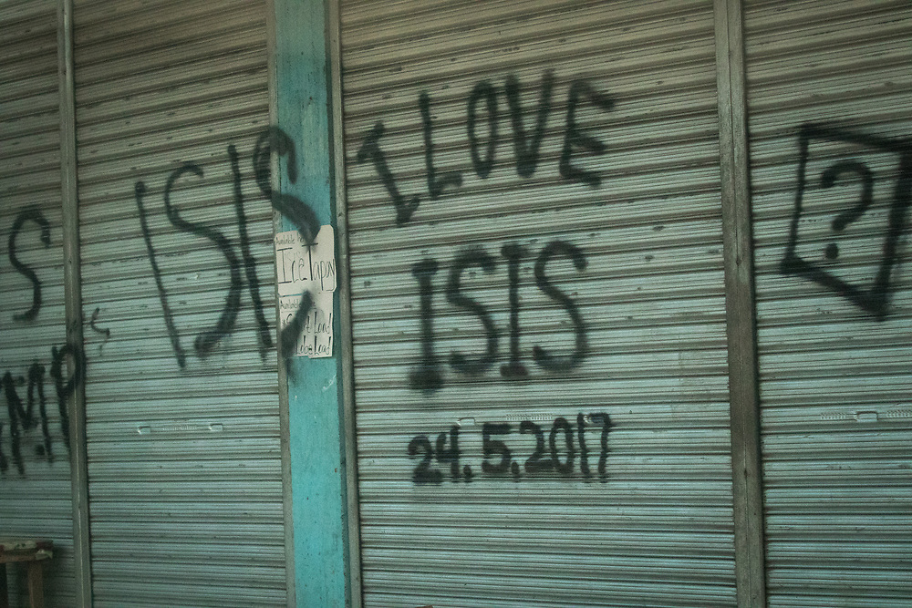 "MARAWI, PHILIPPINES - JUNE 9: Abandoned house vandalized with ""I LOVE ISIS"" is seen in a door of a house inside of a NO GO ZONE in Marawi, southern Philippines on June 9, 2017. Philippine military jets fired rockets at militant positions on Friday as soldiers fought to wrest control of the southern city from gunmen linked to the Islamic State group.(Photo: Richard Atrero de Guzman/NUR Photo)"