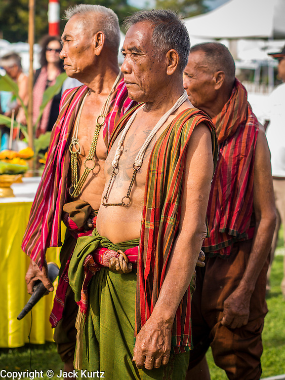 "29 AUGUST 2013 - HUA HIN, PRACHUAP KHIRI KHAN, THAILAND: ""Khru Ba Yai"" or Elephant Spirit Men, participate in a blessing for the elephants before the King's Cup Elephant Polo Tournament in Hua Hin. The tournament's primary sponsor in Anantara Resorts and the tournament is hosted by Anantara Hua Hin. This is the 12th year for the King's Cup Elephant Polo Tournament. The sport of elephant polo started in Nepal in 1982. Proceeds from the King's Cup tournament goes to help rehabilitate elephants rescued from abuse. Each team has three players and three elephants. Matches take place on a pitch (field) 80 meters by 48 meters using standard polo balls. The game is divided into two 7 minute ""chukkas"" or halves. There are 16 teams in this year's tournament, including one team of transgendered ""ladyboys.""    PHOTO BY JACK KURTZ"