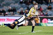 Jordie Barrett looks offload in the tackle during the Super Rugby match, Brumbies V Hurricanes, GIO Stadium, Canberra, Australia, 30th June 2018.Copyright photo: David Neilson / www.photosport.nz