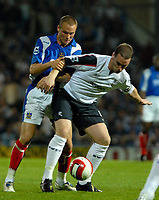 Photo: Ed Godden.<br /> Portsmouth v Bolton Wanderers. The Barclays Premiership. 25/09/2006. Portsmouth's Matthew Taylor (L) tries to get the ball from Kevin Nolan.