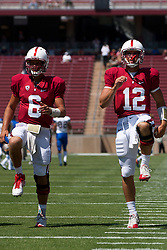September 3, 2011; Stanford, CA, USA;   Stanford Cardinal quarterback Josh Nunes (6) and quarterback Andrew Luck (12) warm up before the game against the San Jose State Spartans at Stanford Stadium.  Stanford defeated San Jose State 57-3.