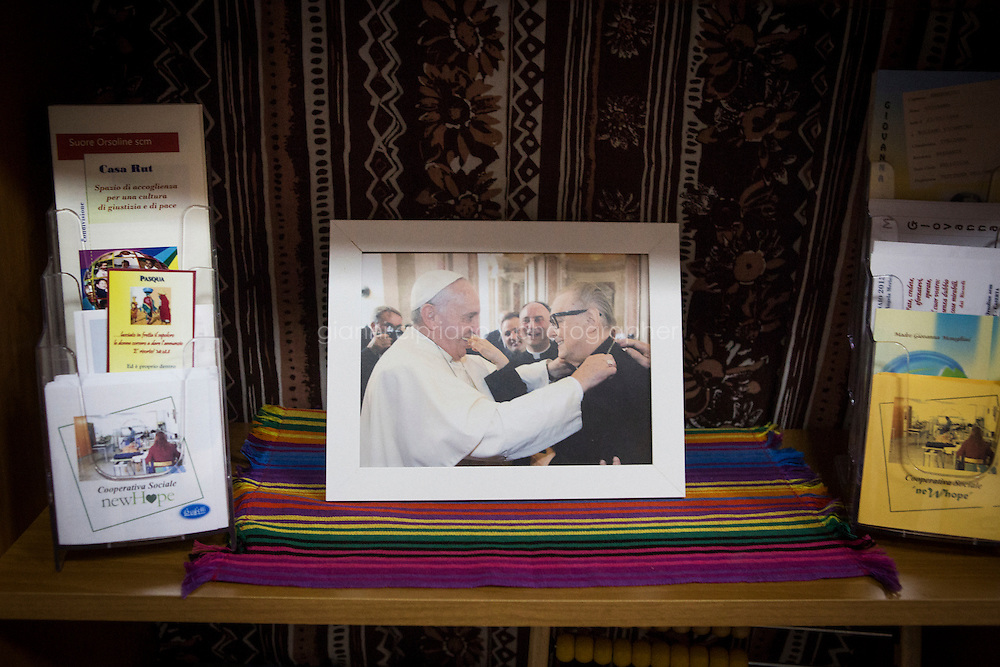 CASERTA, ITALY - 25 FEBRUARY 2015: A photograph of Pope Francis greeting Monsignor Raffaele Nogaro, promoter of Casa Rut, during his visit in Caserta in July 2014, is here on shelf  at Casa Rut, a shelter for abused young immigrant women in Caserta, Italy, on February 25th 2015.<br /> <br /> Casa Rut was founded in 1995 and it is promoted and managed by the Ursuline Sisters of the Sacred Heart of Mary of Breganze (Vicenza, Italy).  Casa Rut's goal is to provide young immigrant women a familiar environment where  they are helped to protect and free themselves, and to undertake a common path aiming to the integration in Italy's society.