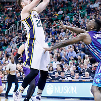 27 January 2016: Utah Jazz forward Gordon Hayward (20) takes a jump shot on Charlotte Hornets forward P.J. Hairston (19) during the Utah Jazz 102-73 victory over the Charlotte Hornets, at the Vivint Smart Home Arena, Salt Lake City, Utah, USA.