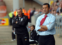 Photo: Kevin Poolman.<br />Northampton Town v Nottingham Forest. Coca Cola League 1. 12/08/2006. <br />Forest manager Colin Calderwood (R) and Northampton manager John Gorman.
