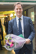 © Licensed to London News Pictures. 13/10/2014. London, UK. Nick Clegg leaves with flowers given to him by the children.  The Deputy Prime Minister, Nick Clegg, visits Greenside Primary School in Shepherd's Bush on Monday 13th October 2014 to launch a new campaign called Primary Futures – a new strand of the Inspiring the Future campaign. Photo credit : Stephen Simpson/LNP