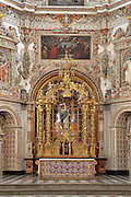 Main altar with gilded wood canopy by Hurtado Izquierdo, 1710, and statues by Jose de Mora, in the Granada Charterhouse or Monasterio de la Cartuja, a Carthusian monastery founded 1506, in Baroque style, in Granada, Andalusia, Southern Spain. Granada was listed as a UNESCO World Heritage Site in 1984. Picture by Manuel Cohen