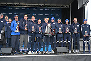 Nov 17, 2018; Madison, WI, USA; Members of Brigham Young men's team and coach Ed Eyestone pose with trophy after placing second during the NCAA Cross Country Championships at the Thomas Zimmer Championship Course.