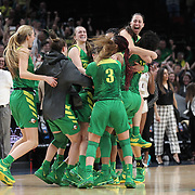 March 31, 2019; Portland, OR, USA; Oregon Ducks  celebrate after the Ducks defeated Mississippi State Bulldogs 88-84 in the Elite Eight of the NCAA Women's Tournament at Moda Center.<br /> Photo by Jaime Valdez
