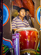 16 JANUARY 2015 - BANGKOK, THAILAND:  The drummer with the Sai Yong Hong Opera Troupe at the Chaomae Thapthim Shrine, a Chinese shrine in a working class neighborhood of Bangkok near the Chulalongkorn University campus. The troupe's nine night performance at the shrine is an annual tradition and is the start of the Lunar New Year celebrations in the neighborhood. Lunar New Year, also called Chinese New Year, is officially February 19 this year. Teochew opera is a form of Chinese opera that is popular in Thailand and Malaysia.   PHOTO BY JACK KURTZ