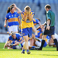 28 September 2008; A dejected Grace Lynch, Clare, as Tipperary players celebrate at the end of the game. TG4 All-Ireland Ladies Intermediate Football Championship Final, Clare v Tipperary, Croke Park, Dublin. Picture credit: David Maher / SPORTSFILE *** NO REPRODUCTION FEE ***