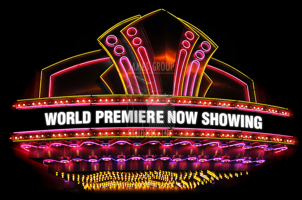 electric, neon movie marquee on black background