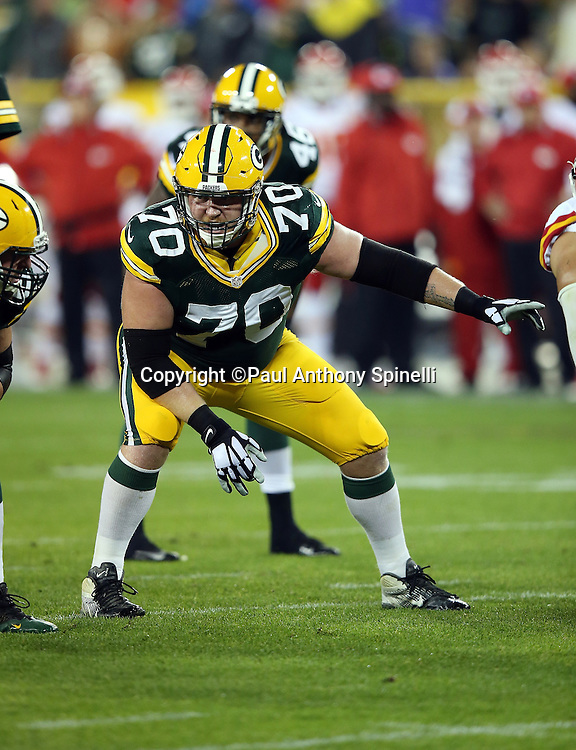 Green Bay Packers guard T.J. Lang (70) points with this left arm as he gets set to block during the 2015 NFL week 3 regular season football game against the Kansas City Chiefs on Monday, Sept. 28, 2015 in Green Bay, Wis. The Packers won the game 38-28. (©Paul Anthony Spinelli)