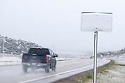 Snow covered highway sign in Utah.