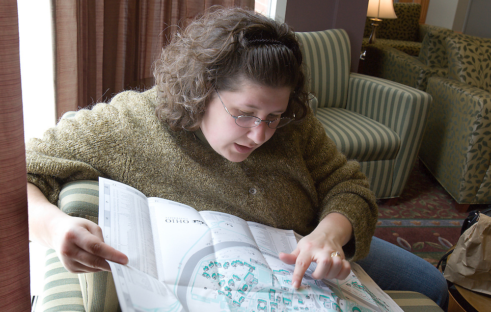 Misty Wilker looks over a campus map while she and her husband Damien, a prospective student, take a break in Baker Center on 4/6/07.