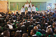 Mamikie , Lungelo and Wanda high five in the final scene of the performance of 'About Us - Stepping Up'  at Ithute primary school, Alexandra township, Johannesburg.