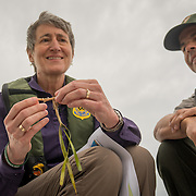 FLORIDA CITY, FLORIDA - APRIL 22, 2016<br /> Sally Jewell, United States Secretary of the interior, along with Pedro Ramos, superintendent of Everglades and Dry Tortugas National Parks in Florida, hold a strand of shoal grass that was floating in the waters of the Everglades National Park  during a trip to look at dying sea grass.<br /> (Photo by Angel Valentin)