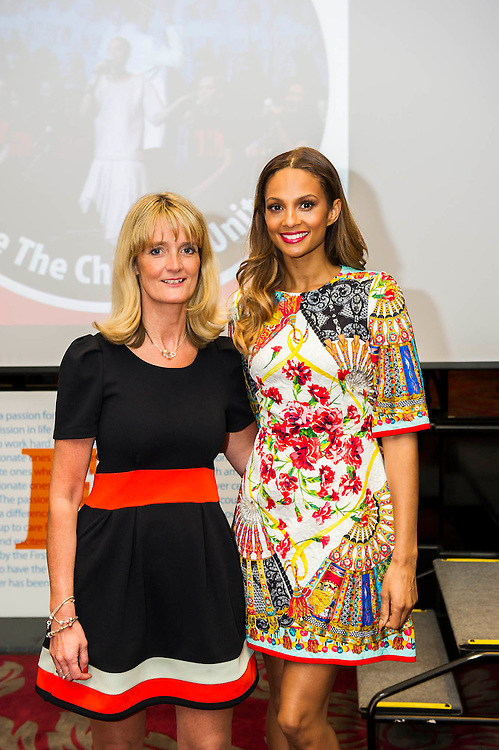 """Alesha Dixon (with Nicky Cox, editor of First News) launches Children United and the """"We Are The Children United"""" single. Alesha is the most well-known name on the single, the first voice you hear on the song is that of 12-year-old Patience who lives in a children's home in Uganda after losing most of her family to AIDS. The pair are joined by thousands more children from countries as far flung as Kenya, Australia, India, USA, Uganda, The Netherlands and Norway who all feature on the Children United single. More countries and more children are joining the """"world's biggest pop group"""" every day and posting their recordings on YouTube. The song was written by Barney Cox and produced by Nigel Wright.<br /> Around 10,000 children's voices are on the song including 6,500 children from the Voice In A Million choir<br /> who performed the song live at Wembley with Alesha in March.<br /> <br /> Children United is an online platform which will bring children together from across the globe to discuss the issues that matter to them, and provide them with the opportunity to have their voices heard. The three founding partner organisations are First News, Achievement for All, and Skoolbo. They have been working with Microsoft to support the web development and integration of Skype technology that will connect children across the world in face-to-face conversations. Save the Children are the charity's key NGO partner.<br /> <br /> The Children United website, which encourages children around the world to """"join-up"""" and be heard, opens for<br /> registration on Wednesday (15 April) and goes fully live and interactive in September. The site will be moderated<br /> by schools around the world to ensure a secure environment for children to talk to each other safely."""
