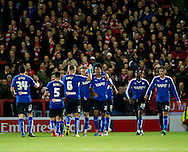 Rai Simons of Chesterfield (centre) is congratulated by his team-mates after he scored his team's 3rd goal during the FA Cup match at Broadhurst Park, Moston<br /> Picture by Russell Hart/Focus Images Ltd 07791 688 420<br /> 09/11/2015
