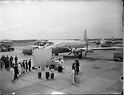 05/06/1955<br /> 06/05/1955<br /> 05th June 1955<br /> Blessing of the Aer Lingus fleet at Dublin Airport. Image shows the prayers at the altar before the aircraft. Note the representatives of various branches of the Aer Lingus organisation on either side of the altar and motor fleet on left.