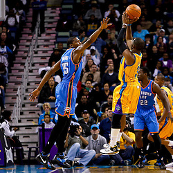 December 10, 2010; New Orleans, LA, USA; New Orleans Hornets point guard Chris Paul (3) shoots over Oklahoma City Thunder forward Kevin Durant (35) during the first half at the New Orleans Arena.  Mandatory Credit: Derick E. Hingle-US PRESSWIRE