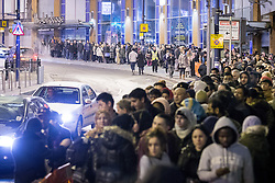 © Licensed to London News Pictures . 26/12/2013 . Manchester , UK . Queues for Next in Manchester's Arndale Centre stretch around the block , ahead of a 6am opening . Thousands of shoppers queue for hours in freezing temperatures in Manchester this Boxing Day morning (26th December 2013) in order to be amongst the first to purchase reduced price products in shops' sales . Photo credit : Joel Goodman/LNP