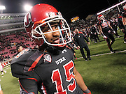 Utah running back John White smiles as walks off the field following the Utes' 27-8 win over Oregon State in an NCAA college football game at Rice-Eccles Stadium, Saturday, Oct. 29, 2011, in Salt Lake City.  White rushed for 217 yards on 35 carries. (AP Photo/Colin E. Braley).