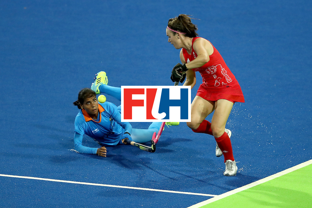 RIO DE JANEIRO, BRAZIL - AUGUST 08:  Vandana Katariya #16 of India defends against Laura Unsworth #4 of Great Britain during a Women's Pool B match on Day 3 of the Rio 2016 Olympic Games at the Olympic Hockey Centre on August 8, 2016 in Rio de Janeiro, Brazil.  (Photo by Sean M. Haffey/Getty Images)