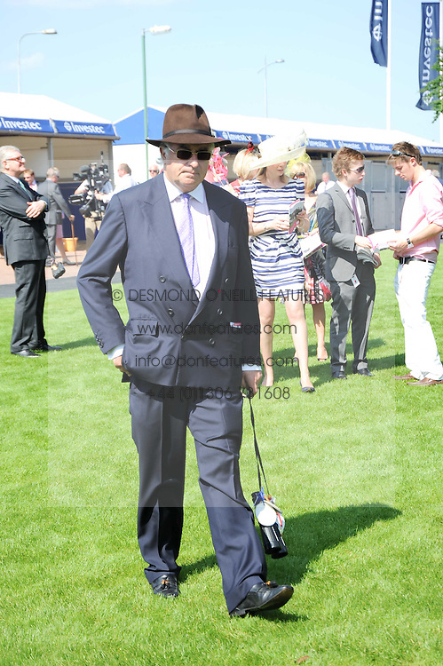 JOHN MAGNIER at the Investec Ladies Day at Epsom Racecourse, Surrey on 4th June 2010.
