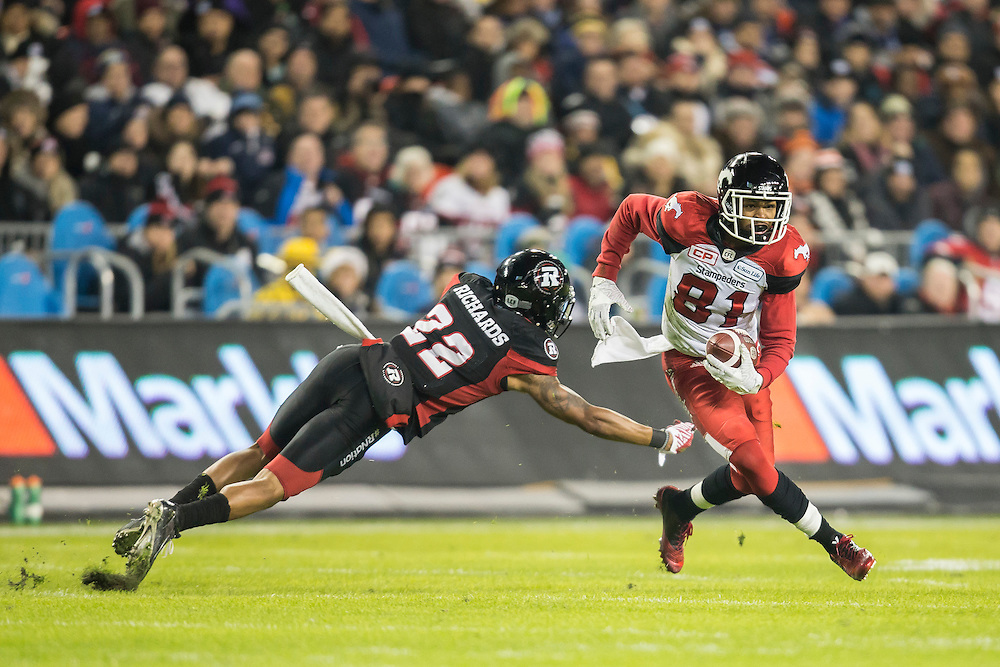 Bakari Grant of the Calgary Stampeders avoids a tackle from Jeff Richards of the Ottawa Redblacks during the 3rd quarter of the 104th Grey Cup in Toronto Ontario, Sunday,  November 27, 2016.  (CFL PHOTO - Geoff Robins)