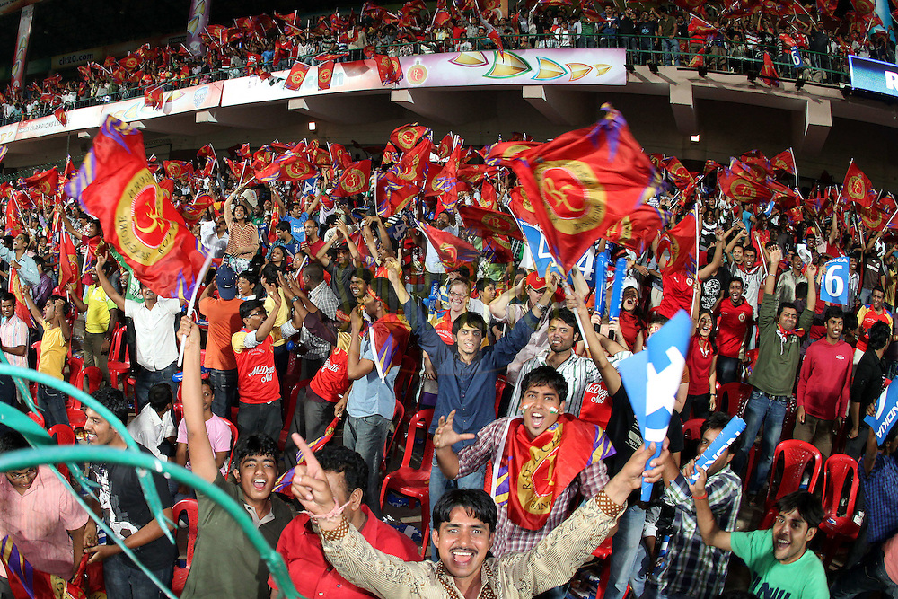 Fans enjoy the CLT20 atmosphere during match 20 of the NOKIA Champions League T20 ( CLT20 )between the Royal Challengers Bangalore and the SA Redbacks held at the  M.Chinnaswamy Stadium in Bangalore , Karnataka, India on the 5th October 2011..Photo by Ron Gaunt/BCCI/SPORTZPICS