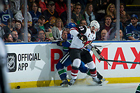 KELOWNA, BC - SEPTEMBER 29: Oliver Ekman-Larsson #23 of the Arizona Coyotes back checks Troy Stecher #51 of the Vancouver Canucks into the boards during third period  at Prospera Place on September 29, 2018 in Kelowna, Canada. (Photo by Marissa Baecker/NHLI via Getty Images)  *** Local Caption *** Troy Stecher; Oliver Ekman-Larsson