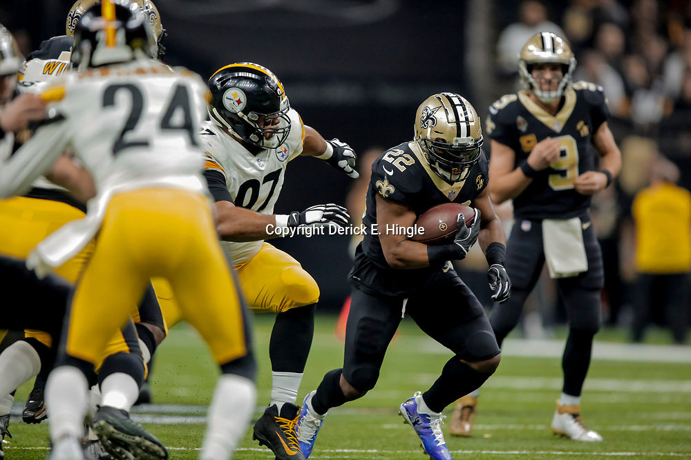 Dec 23, 2018; New Orleans, LA, USA; New Orleans Saints running back Mark Ingram II (22) runs past Pittsburgh Steelers defensive tackle Cameron Heyward (97) during the first quarter at the Mercedes-Benz Superdome. Mandatory Credit: Derick E. Hingle-USA TODAY Sports