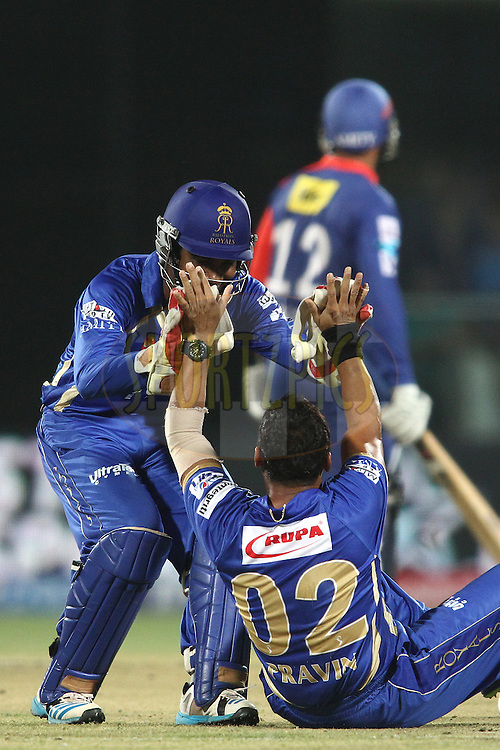 Sanju Samson of the Rajasthan Royals congratulates Pravin Tambe of the Rajasthan Royals for getting Quinton de Kock of the Delhi Daredevils wicket during match 23 of the Pepsi Indian Premier League Season 2014 between the Delhi Daredevils and the Rajasthan Royals held at the Feroze Shah Kotla cricket stadium, Delhi, India on the 3rd May  2014<br /> <br /> Photo by Shaun Roy / IPL / SPORTZPICS<br /> <br /> <br /> <br /> Image use subject to terms and conditions which can be found here:  http://sportzpics.photoshelter.com/gallery/Pepsi-IPL-Image-terms-and-conditions/G00004VW1IVJ.gB0/C0000TScjhBM6ikg