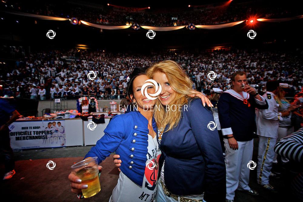 AMSTERDAM - De Toppers in Concert 2012 The Loveboat Edition in de Amsterdam Arena in Amsterdam.  Met op de foto het uitgedoste publiek van de Toppers in Concert The Loveboat editie. FOTO LEVIN DEN BOER - PERSFOTO.NU