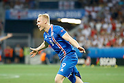 Iceland midfielder Gylfi Þór Sigurðsson (10) celebrates his goal during the Round of 16 Euro 2016 match between England and Iceland at Stade de Nice, Nice, France on 27 June 2016. Photo by Andy Walter.
