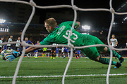 Valencia goalkeeper Neto (13) makes a diving save during the Champions League match between Chelsea and Valencia CF at Stamford Bridge, London, England on 17 September 2019.