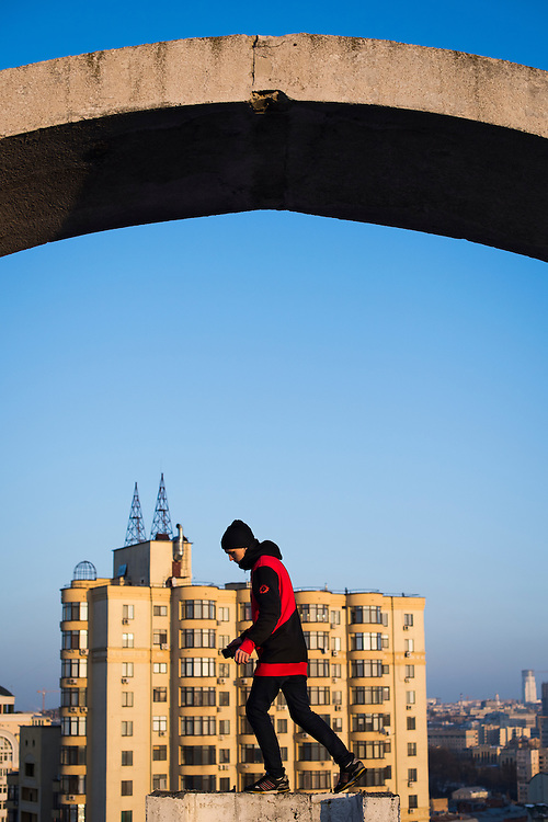 Extreme climber Mustang Wanted poses for a portrait on the roof of a 26-storey building on February 19, 2017 in the Shevchenkovski District of Kiev, Ukraine.