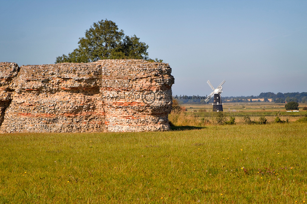 Berney Arms Drainage Mill seen from the Roman Burgh Castle, Norfolk